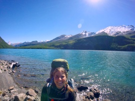 Anne Scholle in front of mountain lake
